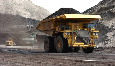 In this April 4, 2013 photo, a truck carrying 250 tons of coal hauls the fuel to the surface of the Spring Creek mine near Decker, Mont.  From the time coal is blasted from strip mines