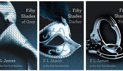 """FILE- This file combo made of book cover images provided by Vintage Books shows the """"Fifty Shades of Grey"""" trilogy by best-selling author E L James. On Monday, E L James"""