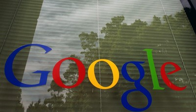 FILE- This April 12, 2012, photo shows a Google logo on a window at the company