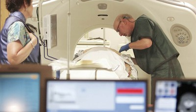 FILE - In this June 3, 2010 file photo, Dr. Steven Birnbaum works with a patient in a CT scanner at Southern New Hampshire Medical Center in Nashua, N.H. The American Cancer Society say