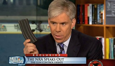 "This video frame grab image provided by""Meet the Press"" shows host David Gregory holding what he described as a high-capacity ammunition magazine during a recent Sunday"