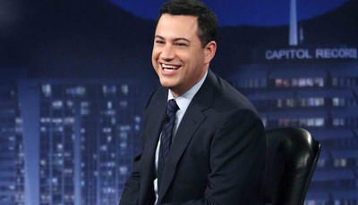 """FILE - This July 25, 2012 photo released by ABC shows Jimmy Kimmel hosting his late night show """"Jimmy Kimmel Live,"""" in the Hollywood section of Los Angeles.  Kimmel said on Friday, Jan."""