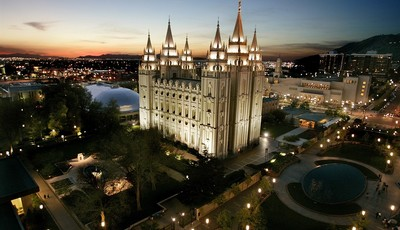 FILE- In this April 27, 2006, file photo, the sun sets behind the Mormon Temple, the centerpiece of Temple Square, in Salt Lake City. The annual spring ritual of bank shareholder meetin