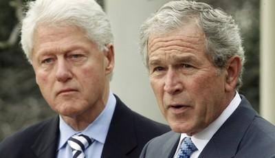 FILE - In this Jan. 16, 2010, file photo, former President Bill Clinton listens to former President George W. Bush speak in the Rose Garden of the White House in Washington. President B