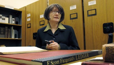 In this Tuesday, March 26, 2013 photo, Elizabeth Sudduth, director of the Ernest F. Hollings Library and Rare Books Collection at the University of South Carolina, talks about a ledger