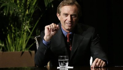 Robert F. Kennedy Jr., left, makes comments during the opening minutes of a interview with journalist Charlie Rose in front of a full audience at the AT&T Performing Arts Center Friday,