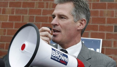 FILE - In this Oct. 24, 2012, file photo, then-Sen. Scott Brown, R-Mass., uses a bull horn at a campaign stop in Watertown, Mass. Three years ago, Brown was a little-known Republican st