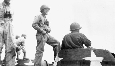 This undated photo made during World War II, shows Eugene Patterson, commander of a tank platoon as Gen. George Patton's 3rd Army drove through the German ranks. Newspaper editor and co