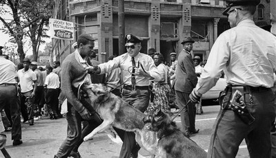 FILE - In this May 3, 1963 file photo, a 17-year-old civil rights demonstrator, defying an anti-parade ordinance of Birmingham, Ala., is attacked by a police dog. 1963 was a year of rev