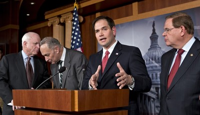 FILE – In this Jan. 28, 2013, file photo Sen. Marco Rubio, R-Fla., center, speaks at a Capitol Hill news conference on immigration legislation with a members of a bipartisan group of le