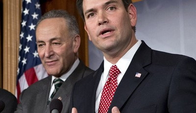 FILE - In this Jan. 28, 2013 file photo, Sen. Marco Rubio, R-Fla., right, accompanied by Sen. Charles Schumer, D-N.Y., gestures as he speaks during a bipartisan group of leading senator