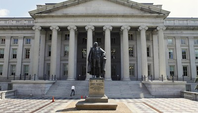 FILE - In this Aug. 8, 2011, file photo, a statue of former Treasury Secretary Albert Gallatin stands outside the Treasury Building in Washington. Absent a magic potion or explosive eco