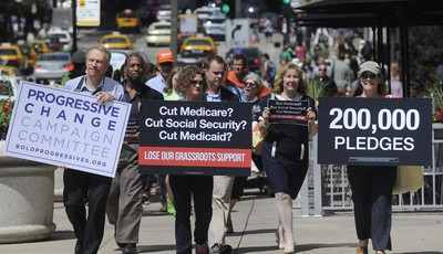 FILE - In this July 15, 2011, file photo, members of  Progressive Change Campaign Committee upset over potential cuts to Medicare, Medicaid and Social Security walk to President Barack
