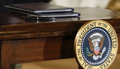 FILE – In this Jan. 26, 2009, file photo executive orders await the signature of President Barack Obama, not pictured, as he speaks about jobs, energy independence and climate change in