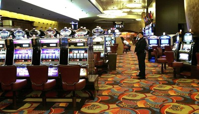 FILE - In this May 13, 2008 file photo, one of the slot machine rooms at the new MGM Grand Hotel stands ready for the start of business at the Foxwoods Resort Casino in Mashantucket, Co