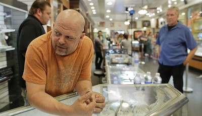 In this Wednesday, April 3, 2013, photo, Rick Harrison, owner of the Gold & Silver Pawn Shop waits as a camera crew prepares to shoot an episode of Pawn Stars at his shop in Las Vegas.