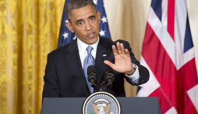 President Barack Obama gestures during a joint news conference with British Prime Minister David Cameron, Monday, May 13, 2013, in the East Room of the White House in Washington, where