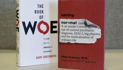"This Monday, May 13, 2013 photo shows the books ""The Book of Woe"" by Gary Greenberg and ""Saving Normal"" by Allen Francis on display in Chicago. Recent criticism of changes in an update"