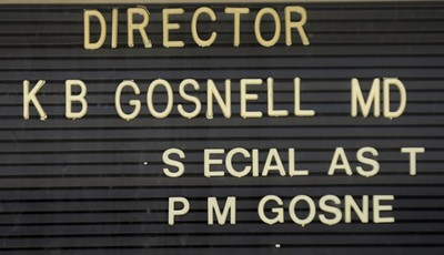 In this May 1, 2013 file photo, letters are missing from the directory of Dr. Kermit Gosnell