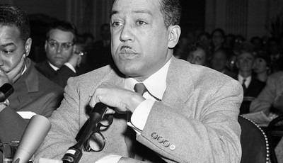 FILE - This March 26, 1953 file photo shows poet and author Langston Hughes speaking before the House Un-American Activities Committee (HUAC) in Washington, D.C. Hughes, Adrienne Rich,