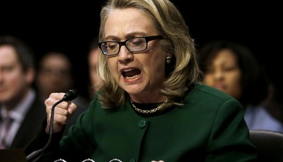 FILE – In this Jan.23, 2013, file photo U.S. Secretary of State Hillary Rodham pounds her fist as she testifies on Capitol Hill in Washington at the Senate Foreign Relations Committee h