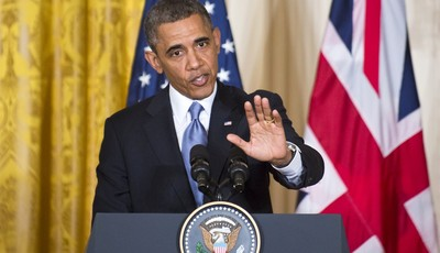 In this photo taken May 13, 2013, President Barack Obama defends his administration