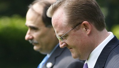 FILE - In this Aug. 11, 2009, file photo Senior White House Adviser David Axelrod, left, White House Press Secretary Robert Gibbs, right, leave with President Barack Obama, not shown, f