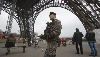 A French soldiers patrols under the Eiffel tower, Sunday, Jan. 13, 2013.  France has ordered tightened security in public buildings and transport following action against radical Islami