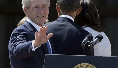 FILE – In this April 25, 2013, file photo former President George W. Bush turns to wave as he leaves with President Barack Obama and first lady Michelle Obama after the dedication of th