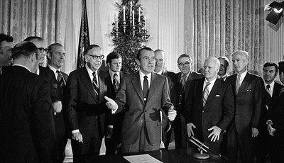 FILE - In this Dec. 23, 1971 file photo, President Richard Nixon addresses a gathering in the White House State Dining Room after signing the National Cancer Act, a $1.6 billion federal