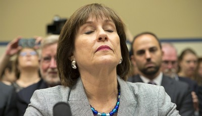 Lois Lerner, head of the IRS unit that decides whether to grant tax-exempt status to groups, listens on Capitol Hill in Washington, Wednesday, May 22, 2013, during a House Oversight and