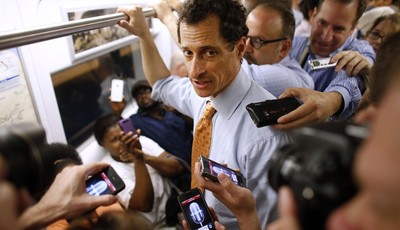 New York City mayoral hopeful Anthony Weiner speaks to reporters as he rides the subway to a radio appearance on the first day of his campaign, Thursday, May 23, 2013 in New York. Weine