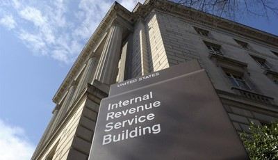FILE - This March 22, 2013 file photo shows the exterior of the Internal Revenue Service building in Washington. No one answered the phone at the IRS hotline for tax help. Forget about