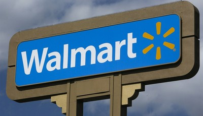 An outdoors sign for Walmart is seen in Duarte, Calif. Tuesday, May 28, 2013. Wal-Mart Stores Inc. pleaded guilty on Tuesday to charges the company dumped hazardous waste in Calif. Wal-