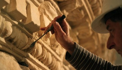A restorer at the Israel Museum works on a reassembled display of what curators say was Herod