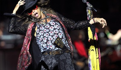 FILE - This May 25, 2013 file photo shows Steven Tyler, lead singer of American rock band Aerosmith performing in Singapore during the inaugural Social Star Awards concert. Aerosmith, J