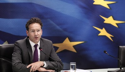 Jeroen Dijsselbloem, who heads the finance ministers of the 17 European Union countries that use the euro, answers questions during a  join news conference with Greek Finance Minister