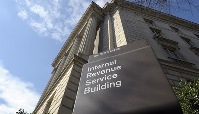 FILE - This March 22, 2103 file photo shows the exterior of the Internal Revenue Service building in Washington. For a time, the Internal Revenue Service inspired awe and admiration in