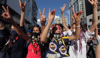 Turkish youths shout anti-government slogans as they march in Ankara, Turkey, Tuesday, June 4, 2013. Turkey
