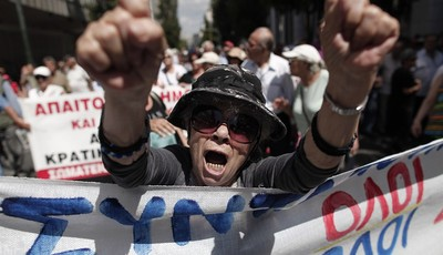 An elderly woman chants anti-austerity slogans during a protest by hundreds of pensioners in central Athens, Thursday, June 6, 2013. Elderly Greeks have faced successive pension cuts si
