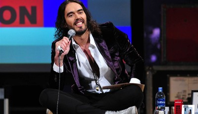 "This March 14, 2013 photo released by FX shows Russell Brand, host of the FX series ""Brand X with Russell Brand."" The British comedian announced Thursday, June 6, that he"