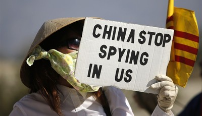 A woman from the Vietnamese American community holds a sign during a protest against China near the Annenberg Retreat at Sunnylands in Rancho Mirage, Calif., Friday, June 7, 2013. Presi