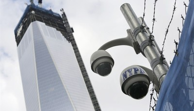 FILE- In this Monday, Feb. 25, 2013, file photo, New York Police Department security cameras are in place at the National September 11 Memorial and Museum, in New York. Since Sept. 11,