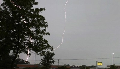Lightning flashes near Wauconda, Ill. High School Wednesday, June 12, 2013 evening as storms roll into the Suburbs of Chicago. A massive line of storms packing hail, lightning and tree-