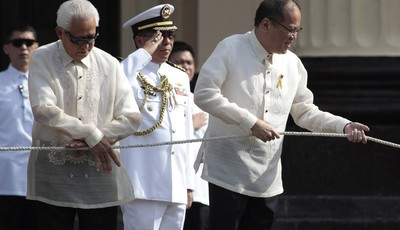 Philippine President Benigno Aquino III, right, leads flag raising ceremonies to mark the 115th Philippine Independence Day at Liwasang Bonifacio, a square named after Filipino revoluti