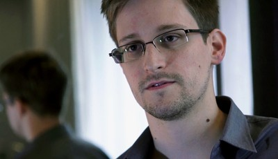 This photo provided by The Guardian Newspaper in London shows Edward Snowden, who worked as a contract employee at the National Security Agency, in Hong Kong, Sunday, June 9, 2013. Disc