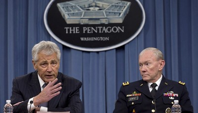 FILE – In this May 17, 2013 file photo Defense Secretary Chuck Hagel, left, and Chairman of the Joint Chiefs of Staff, Gen. Martin Dempsey take turns talking to media during a news conf