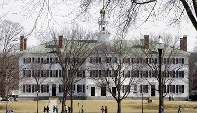 FILE--In this photo taken on March 12, 2012, students walk across the Dartmouth College campus green in Hanover, N.H. High school students hoping to earn college credits through Advance