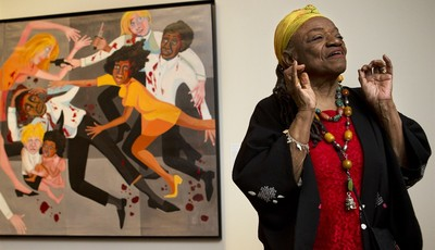 "Artist Faith Ringgold talks about her artwork in front of her painting, ""Die (1967)"" during a press preview of her exhibition, ""American People, Black Light: Faith Ringgold's Paintings"