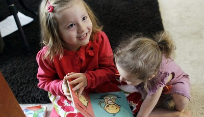FILE -In this Monday, Feb. 25, 2013, file photo, Coy Mathis, left, plays with her sister Auri, at their home in Fountain, Colo.  Coy has been diagnosed with Gender Identity Disorder. Bi